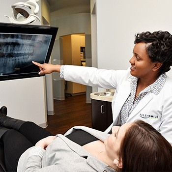 Allen dentist and patient looking at dental x-rays