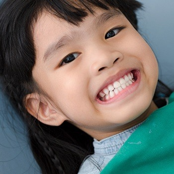 Child smiling after receiving tooth-colored filling