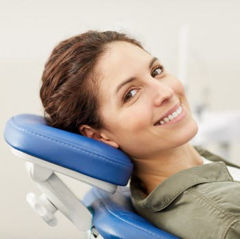 Woman in dental chair before diagnosis of periodontal disease