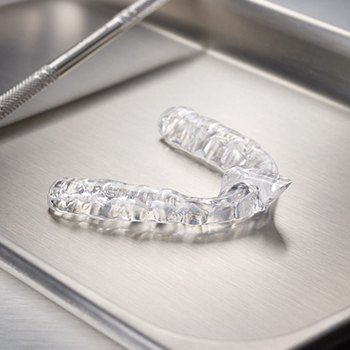 Clear nightguard for bruxism to prevent teeth grinding and clenching on metal tray