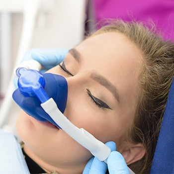 Relaxed dental patient with nitrous oxide sedation dentistry mask