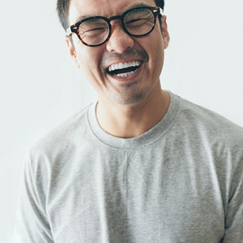 person with porcelain veneers laughing.