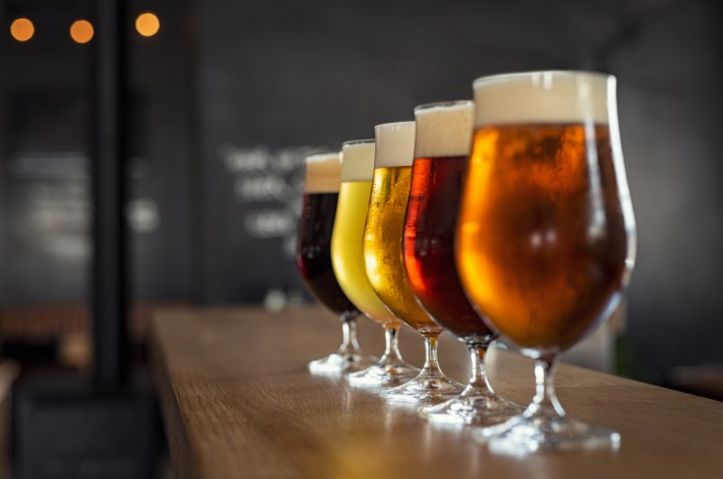 Line up of different colored beers